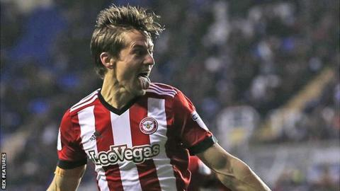 Lasse Vibe celebrates scoring a goal for Brentford