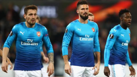 Arsenal's players react after falling behind to Cologne in the Europa League