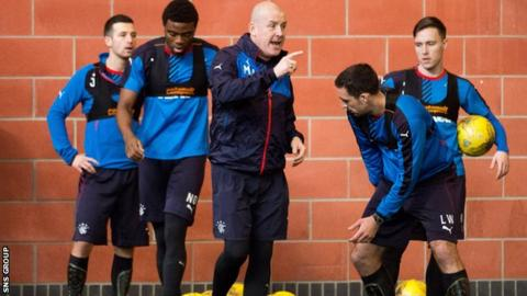 Mark Warburton leads an indoor training session at Murray Park