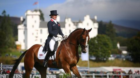 Equestrian rider on horse with Blair Castle in the background