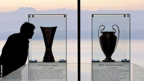 Champions League and Europa League trophies