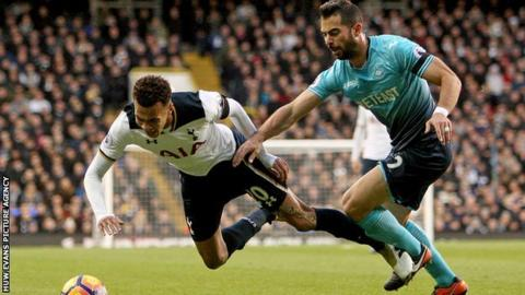 Jordi Amat in action against Spurs' Dele Alli