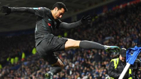 Pedro of Chelsea kicks the corner flag as he celebrates scoring their second goal during The Emirates FA Cup Quarter Final match between Leicester City and Chelsea at The King Power Stadium on March 18, 2018 in Leicester, England.