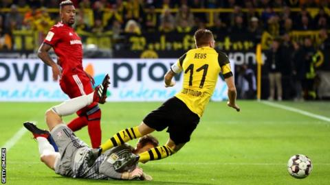 Marco Reus is fouled by Manuel Neuer