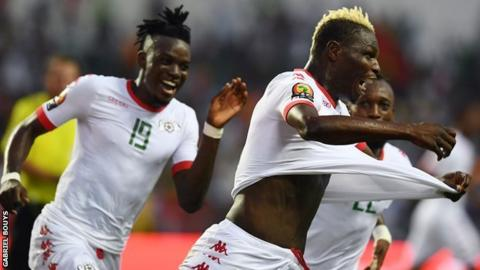 Aristide Bance (right) wheels away in delight after scoring the opener