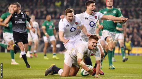 England's Henry Slade scores a try against Ireland