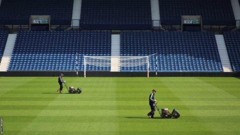 Groundsmen prepare the pitch at the Hawthorns Stadium, home of West Bromwich Albion