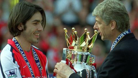 Robert Pires and Arsene Wenger in 2002 after Arsenal are crowned Premier League champions