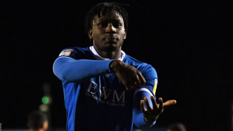 Josh Kayode of Carlisle United celebrates scoring their second goal