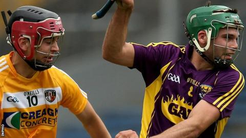 Antrim's Maol Connolly in action against Conor Devitt of Wexford