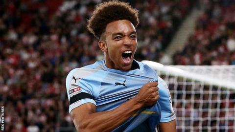 Donovan Wilson celebrates scoring for Wolves at Southampton