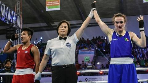 Kellie Harrington's hand is raised after the lightweight final at the Women's World Boxing Championships