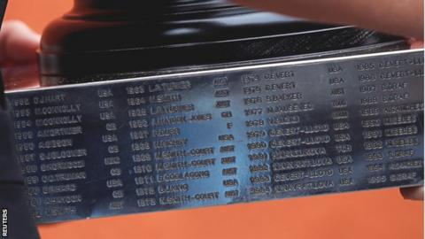 A picture of the trophy showing AUST next to Barker's name