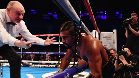 David Haye falls through the ropes during his Heavyweight contest against Tony Bellew at The O2 Arena on March 4, 2017