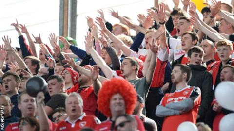 Morecambe supporters cheer at Coventry