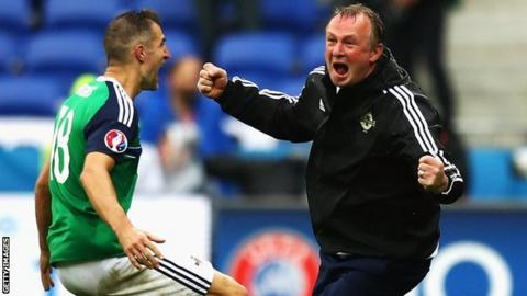 Aaron Hughes and Michael O'Neill celebrate after Niall McGinn's goal in Northern Ireland's 2-0 win over Ukraine at Euro 2016