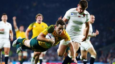 Bernard Foley scores a try for Australia against England at the 2015 Rugby World Cup