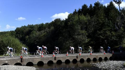 Kelso, Scotland, September 8: The peloton crosses the River Whiteadder during stage two of the Tour of Britain (Photo by Iajn Rutherford/PA Wire).
