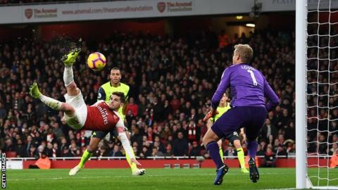 Arsenal midfielder Lucas Torreira scores a fine overhead kick to secure victory over Huddersfield