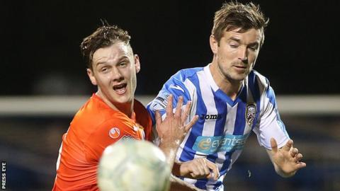 Seanan Clucas and Steven Douglas challenge for the ball as Coleraine and Dungannon drew 2-2 in October