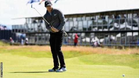 Rory McIlroy watches his putt just drift past the hole on the 16th at Troon on Thursday