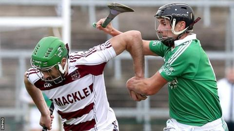 Slaughtneil's Chrissy McKaigue attempts to burst away from Ballygalget's Declan McManus
