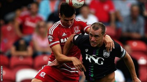 Daniel Ayala of Middlesbrough and Aaron Wilbraham of Bristol City