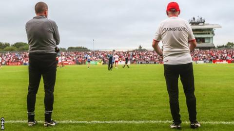 Mickey Harte (right) and assistant coach Stephen O'Neill watch Saturday's game at Healy Park