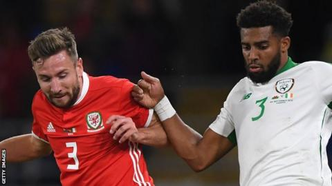 Wales' Paul Dummett and Republic of Ireland's Cyrus Christie compete for the ball
