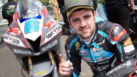 Michael Dunlop celebrates the Supersport win which was his 27th podium finish in 40 Isle of Man TT races