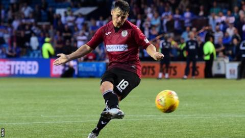 Danny Mullen scores the winning penalty for St Mirren