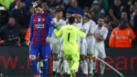 Barcelona's Lionel Messi reacts at the final whistle after Real Madrid win El Clasico