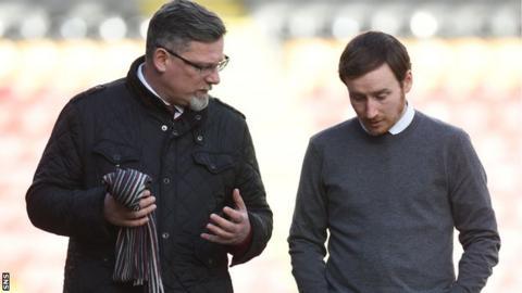 Craig Levein talks to Ian Cathro, the club's former head coach