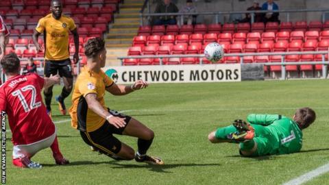 Newport County midfielder Ben White sees his shot saved by Crewe Alexandra goalkeeper Ben Garratt