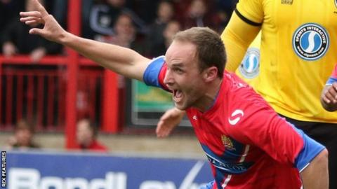 Scott Doe scores against AFC Wimbledon during his previous spell with Dagenham & Redbridge