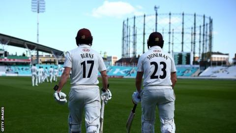 Rory Burns walks out to bat with Surrey opening partner Mark Stoneman