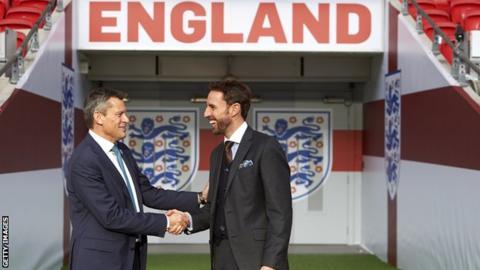 Martin Glenn shakes hands with Gareth Southgate