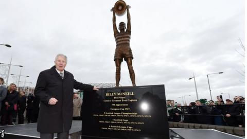 Billy McNeill stands alongside his statue