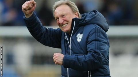 Neil Warnock celebrates post patch