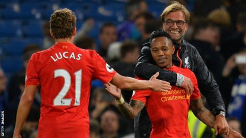 Liverpool manager Jurgen Klopp celebrates with Lucas and Nathaniel Clyne