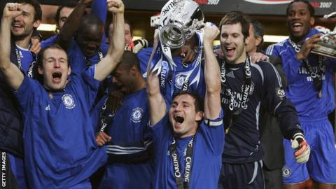 Frank Lampard with Chelsea team mates celebrate winning the League Cup