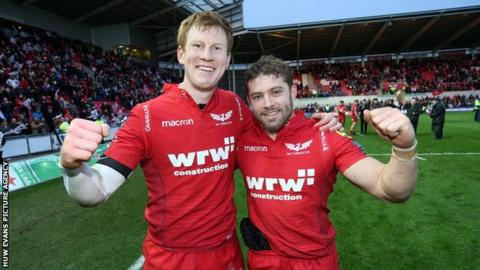 Rhys Patchell and Leigh Halfpenny celebrate victory against La Rochelle in the Champions Cup quarter-final