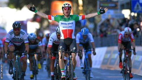 Italian champion Elia Viviani spreads his arms out to celebrate winning stage three of Tirreno-Adriatico