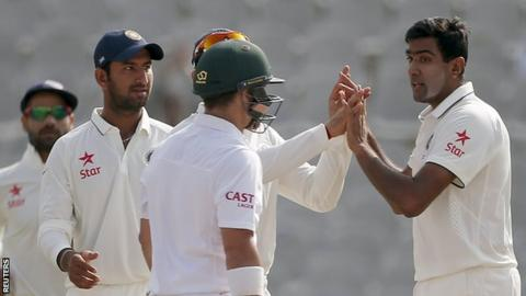 India's Ravichandran Ashwin (right) celebrates a wicket