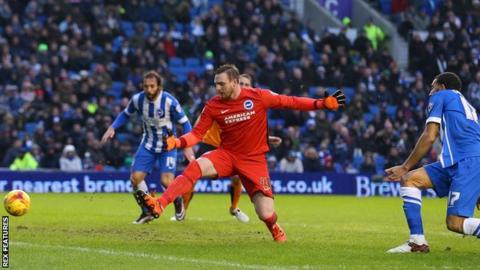 Brighton defender Connor Goldson diverts the ball past his own goalkeeper, David Stockdale
