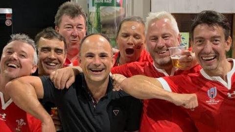 Jaco Peyper poses with Wales fans