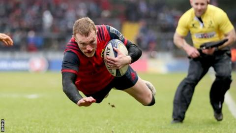 Keith Earls takes to the air as he goes goes over for a Munster try in the final pool game against Castres in Limerick