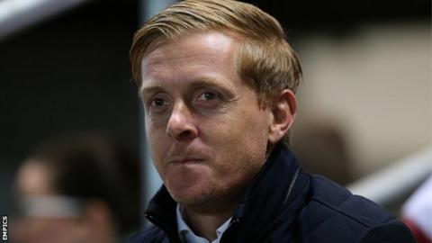 Garry Monk watches on from the sidelines