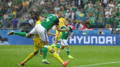 Gareth McAuley heads Northern Ireland in front against Ukraine