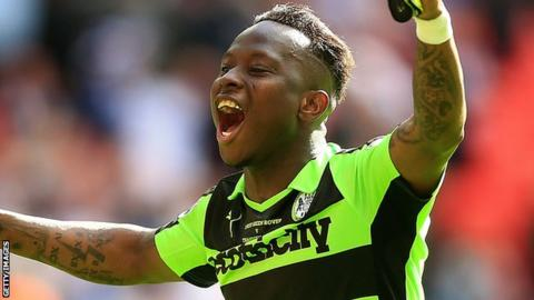 Drissa Traore celebrates Forest Green's victory over Tranmere in the National League play-off final